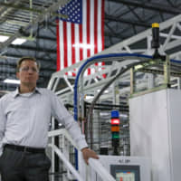 Tom Werner, chairman and chief executive officer of SunPower Corp., stands for a photograph at a facility in Hillsboro, Oregon, Aug. 7. Over the past two years, SunPower was hit with duties on panels it makes overseas; won an exemption; was threatened with tariffs on equipment it makes in Mexico; and watched rivals gain access to a tariff loophole.
