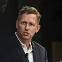 Peter Thiel, co-founder and chairman of Palantir Technologies, speaks at The New York Times DealBook conference in New York last November. | PHOTOGRAPHER: STEPHANIE KEITH/GE