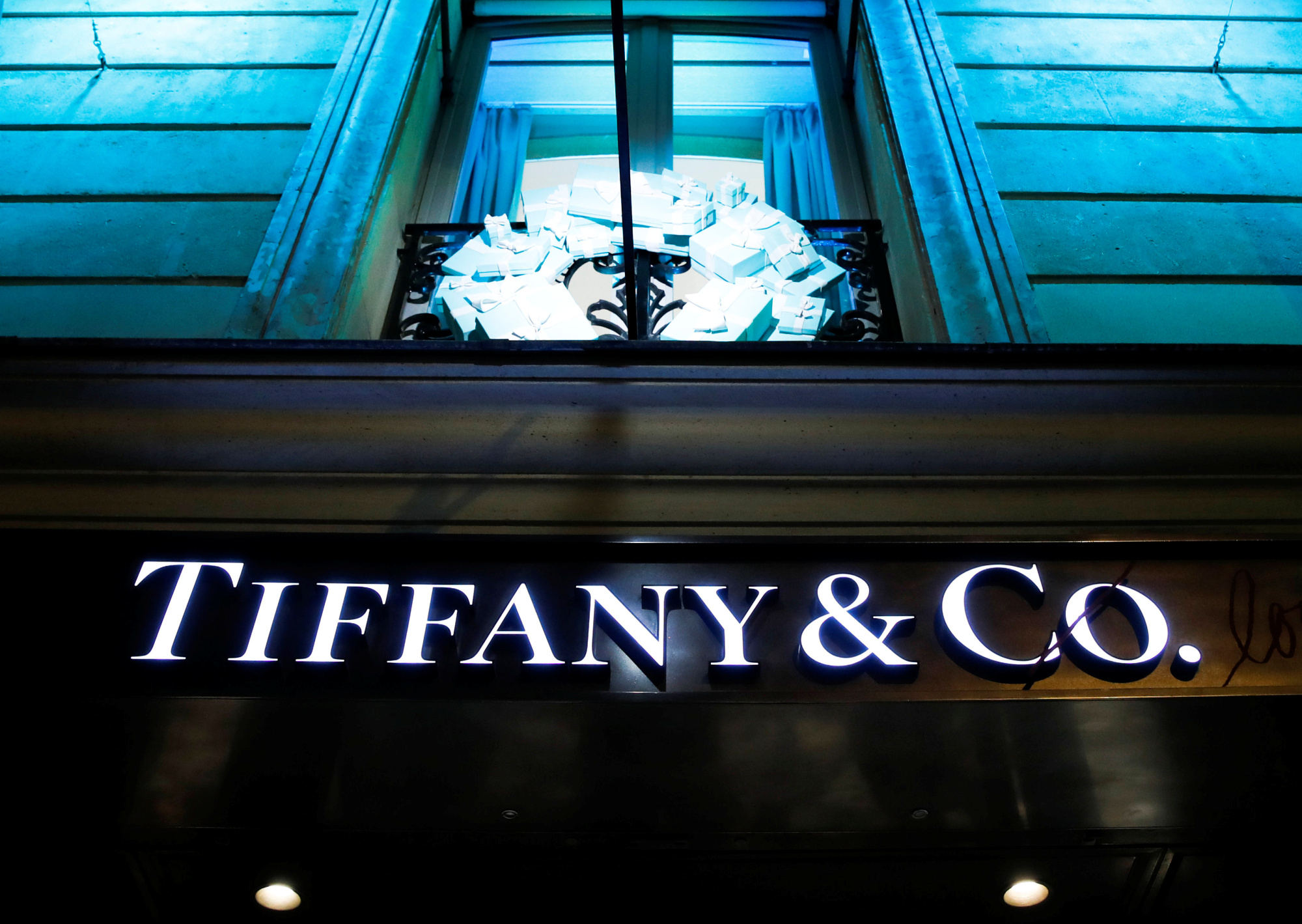 The Tiffany & Co. logo is seen outside a store in Paris Friday. | REUTERS