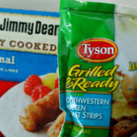 Tyson foods Inc. and Hillshire Brands Jimmy Dean sausages are shown in this photo illustration in Encinitas, California, in 2014. | REUTERS