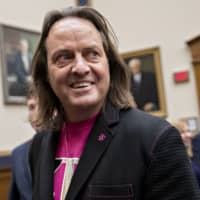 John Legere, chief executive officer of T-Mobile US Inc., waits to begin a House Judiciary Subcommittee hearing in Washington in March. | BLOOMBERG