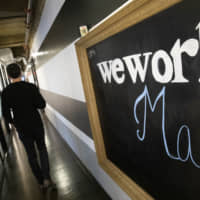 A WeWork office space is seen Nov. 5 in New York. WeWork says it racked up $1.25 billion in losses in the third quarter as it geared up for an ultimately scuttled stock market debut. WeWork's losses more than doubled between June-September, compared to the same period the previous year, as the office-sharing company spent heavily in pursuit of aggressive growth. | AP