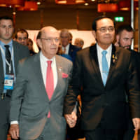 Thai Prime Minister Prayuth Chan-ocha and U.S. Commerce Secretary Wilbur Ross (second, left) attend their bilateral meeting in Bangkok Sunday. | THAILAND GOVERNMENT HOUSE / HANDOUT / VIA REUTERS