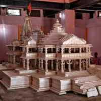 Devotees on Oct. 22 look at a model of the Ram temple that Hindu groups want to build on a disputed religious site in Ayodhya, India. | REUTERS