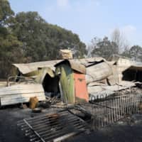 A burned home near Colo Heights, northwest of Sydney, is pictured Saturday. | AAP IMAGE/DAN HIMBRECHTS / VIA REUTERS