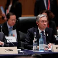 China's Foreign Minister Wang Yi and Canada's Foreign Minister Francois-Philippe Champagne attend the G20 foreign ministers' meeting in Nagoya on Saturday.   REUTERS