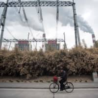 China can be rich, climate neutral by 2050, global energy group's report says