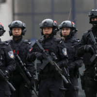 Serbian and Chinese security forces perform a joint anti-terrorist drill in the Zelezara Smederevo steel mill, in the city of Smederevo, 45 km east of Belgrade, on Thursday. | AP
