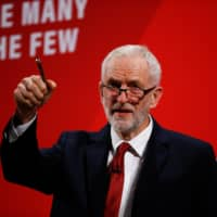 U.K. opposition Labour Party leader Jeremy Corbyn speaks at the Bernie Grant Arts Centre in London on Tuesday. | REUTERS