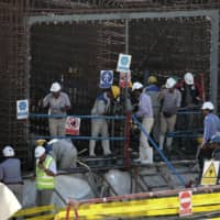 Construction takes place Sunday at Iran's Bushehr nuclear power plant during a ceremony to kick-start work on a second reactor at the facility. | AFP-JIJI