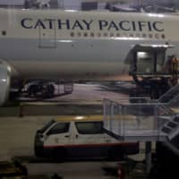 Workers service a Cathay Pacific flight at Hong Kong International Airport on Sept. 3.   REUTERS