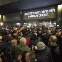 Demonstrators gather to protest the film 'And Then We Danced' in Tbilisi on Friday. Hundreds of demonstrators assembled outside a movie theater in the capital to protest against the showing of  the film, which is about two young male Georgian ballet dancers falling in love. | AP