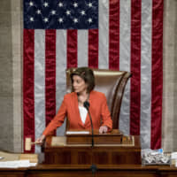 U.S. House Speaker Nancy Pelosi uses her gavel as the House votes 232-196 to pass a resolution on impeachment procedure to move forward into the next phase of the impeachment inquiry into President Donald Trump on Thursday. | AP