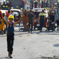 Iraqi forces shoot dead 13 protesters in renewed crackdown on unrest