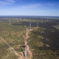 Wind turbines stand at Kennedy Energy Park in the Australian state of Queensland. | BLOOMBERG