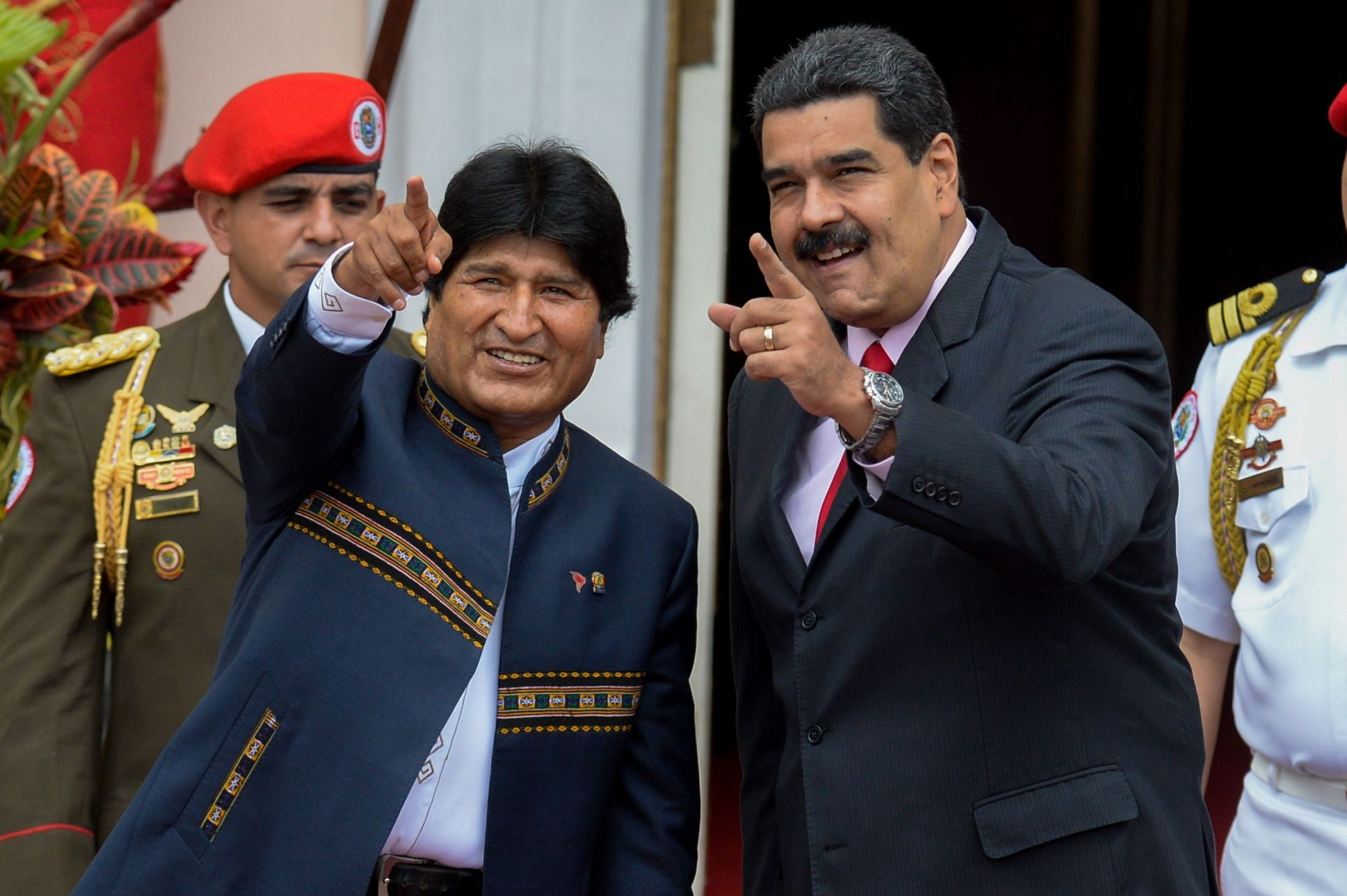 Venezuelan President Nicolas Maduro (right) and Bolivian President Evo Morales gesture during the Bolivarian Alliance for the Peoples of Our America (ALBA) summit at the Miraflores presidential palace in Caracas in 2017. Morales resigned on Sunday, caving in following three weeks of sometimes-violent protests over his disputed re-election after the army and police withdrew their backing.   AFP-JIJI