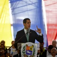 Venezuelan opposition leader and self-proclaimed acting president Juan Guaido speaks during a meeting with union leaders, in Caracas on Monday. Guaido said Monday the resignation of Bolivian President Evo Morales was a 'hurricane of democracy' and renewed his call for protests against Venezuelan President Nicolas Maduro.   AFP-JIJI