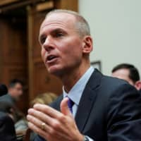 Boeing Chief Executive Dennis Muilenburg testifies before the House Transportation and Infrastructure Committee during a hearing on the grounded 737 Max in the wake of deadly crashes, on Capitol Hill in Washington Oct. 30. | REUTERS