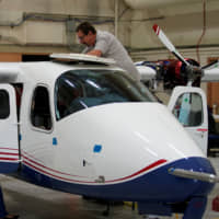 Technicians work on the X-57 Maxwell all-electric plane in a hangar at NASA's Armstrong Flight Research Center at Edwards Air Force Base, California, on Friday. | REUTERS