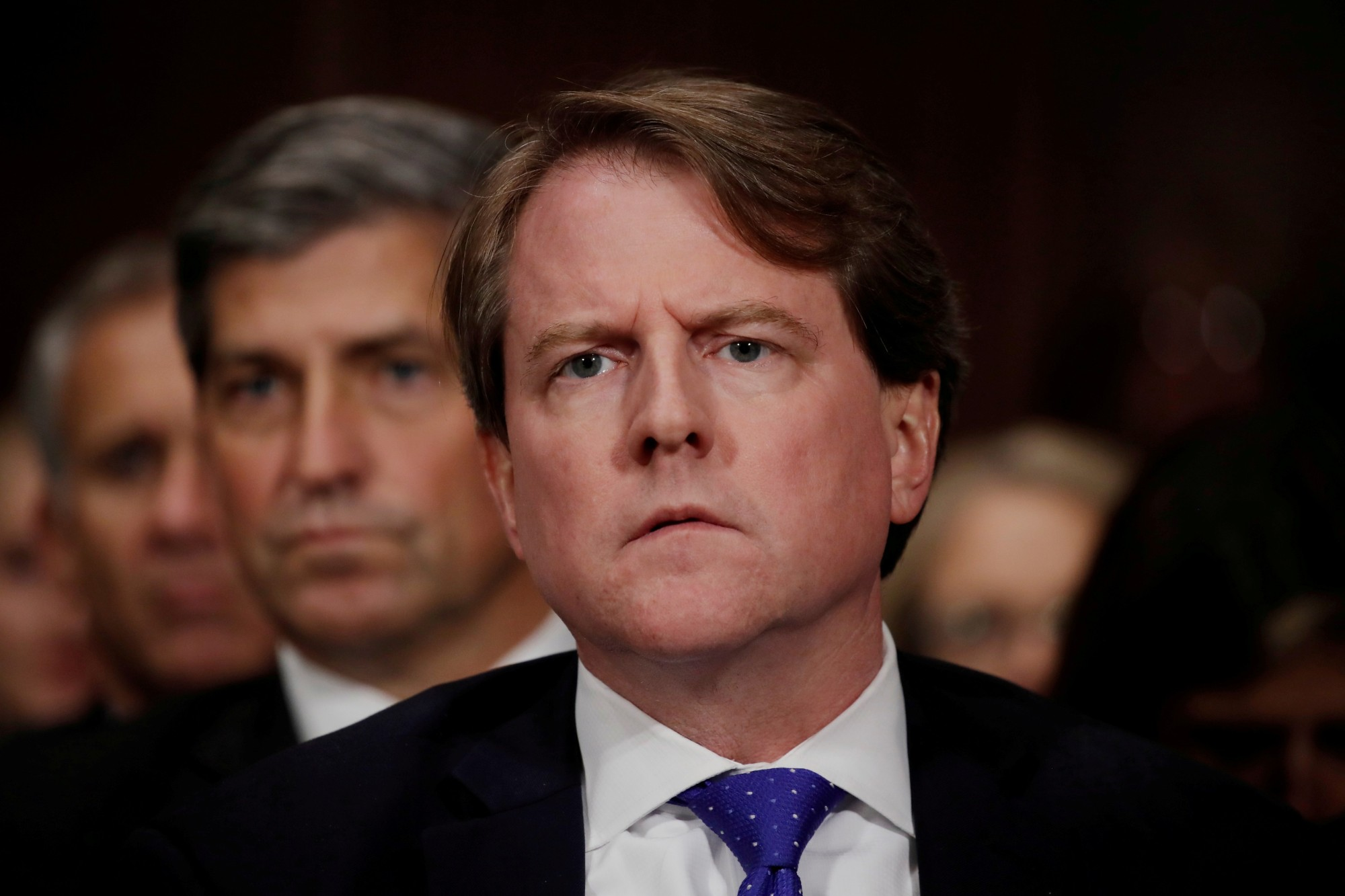 Then-White House counsel Don Mcgahn listens to U.S. Supreme Court nominee Brett Kavanaugh testify before a Senate Judiciary Committee confirmation hearing on Capitol Hill in Washington in September 2018. | REUTERS