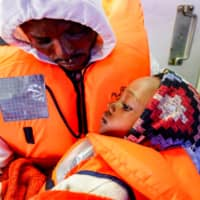 Spanish rescue ship stranded in heavy seas off Italy with 62 African migrants on board awaiting port OK