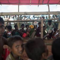 Rohingya Muslim refugees line up to receive food at the Balukhali refugee camp, near the town of Gumdhum in Cox's Bazar, Bangladesh, in 2017. | AFP-JIJI