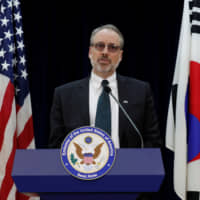 James DeHart, the top U.S. negotiator in talks with South Korea on a new cost-sharing agreement for hosting the U.S. military, speaks at the American Embassy in Seoul on Tuesday after meeting with his South Korean counterpart. | REUTERS