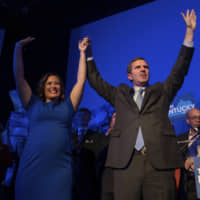 Democratic gubernatorial candidate and Kentucky Attorney General Andy Beshear, along with lieutenant governor candidate Jacqueline Coleman, acknowledge supporters at the Kentucky Democratic Party election night watch event Tuesday in Louisville, Kentucky. | AP