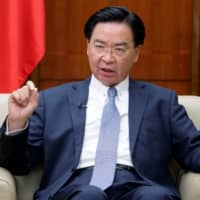 Taiwan warns of possible attack if China's slowdown 'becomes serious'