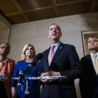 Rep. Adam Schiff, a Democrat from California and chairman of the House Intelligence Committee, speaks with members of the media on Capitol Hill in Washington Wednesday. House Democrats are opening the public phase of their impeachment inquiry of Donald Trump next week with some of their central witnesses to detail the president's pressure on Ukraine to investigate a political rival. | BLOOMBERG