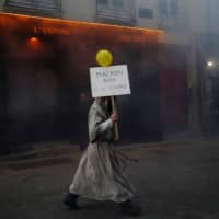 A protester dressed as a monk attends a demonstration to mark the first anniversary of the yellow vest movement in Nantes, France, on Saturday. | REUTERS