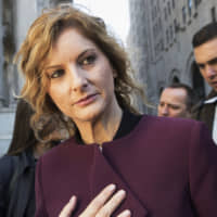 Summer Zervos leaves New York state appellate court in New York last fall. Records filed in Zervos' defamation suit and obtained Monday by The Associated Press indicate that Zervos, a former 'Apprentice' contestant, got a call from Trump's phone on Dec. 21, 2007, when she says he rang to invite her to dinner. She says she went for career advice and was sexually assaulted. | AP