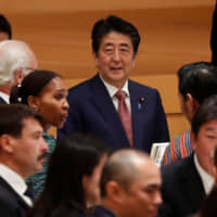 Prime Minister Shinzo Abe hosts a banquet for newly enthroned Emperor Naruhito at the Hotel New Otani in Tokyo on Oct. 23. | REUTERS