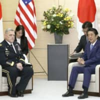 U.S. Chairman of the Joint Chiefs of Staff Gen. Mark Milley and Prime Minister Shinzo Abe hold talks in Tokyo on Tuesday. | KYODO
