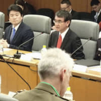 Defense Minister Taro Kono speaks during a meeting with his Australian counterpart, Linda Reynolds, at the Defense Ministry in Tokyo on Wednesday. | KYODO