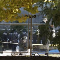 """Police investigate a park in the Higashishimbashi district of Tokyo's Minato Ward Friday after the body of a newborn was found buried there. 