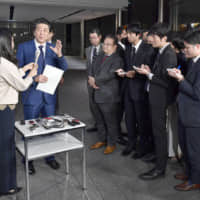 Prime Minister Shinzo Abe speaks in a burasagari interview with reporters at the Prime Minister's Office on Nov. 15. | KYODO