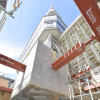 One of the four pedestals of Nagoya Television Tower is seen cut off from its concrete foundation on Oct. 23. | CHUNICHI SHIMBUN