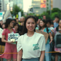 Saori Iwano, a 16-year-old member of Fridays For Future Tokyo, stands before a growing crowd in Shibuya Ward, Tokyo, on Sept. 20 as people gather to take part in the Global Climate Strike. | RYUSEI TAKAHASHI