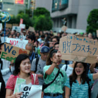 More than 2,800 people march through the streets of Shibuya, Tokyo, during the Global Climate Strike on Sept. 20. Five thousand took part nationwide as more than 7.6 million gathered in 185 countries around the world. | RYUSEI TAKAHASHI