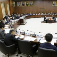 Lawmakers attend a session to discuss constitutional amendments at the Diet on Thursday in Tokyo.   KYODO