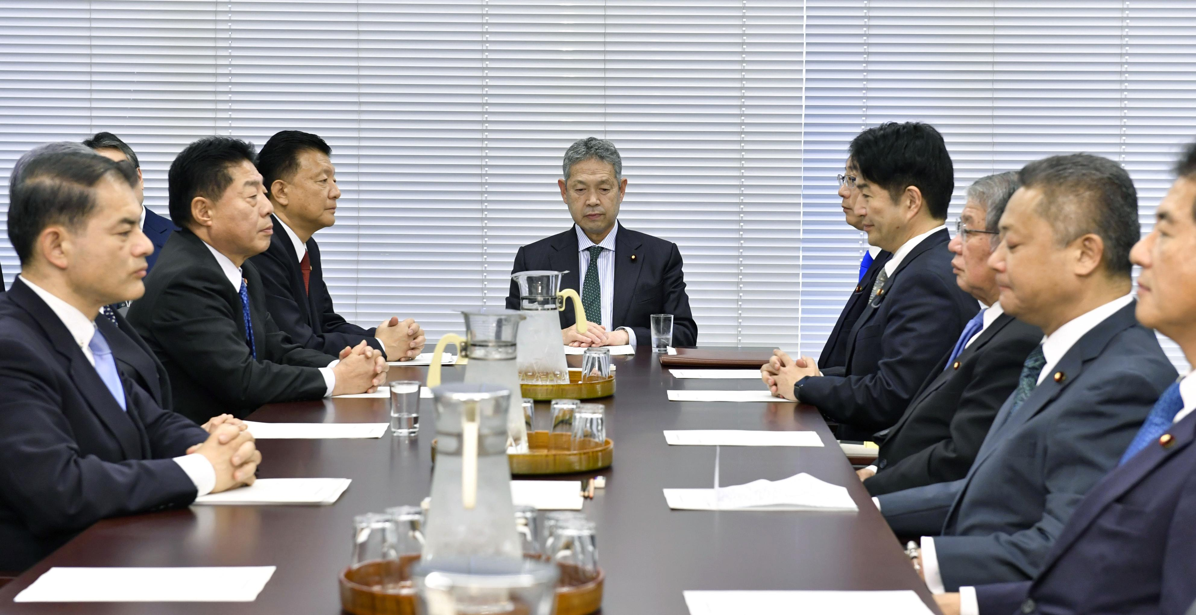 Members of the Lower House special Diet committee on constitutional affairs meet in Tokyo on Thursday. | KYODO