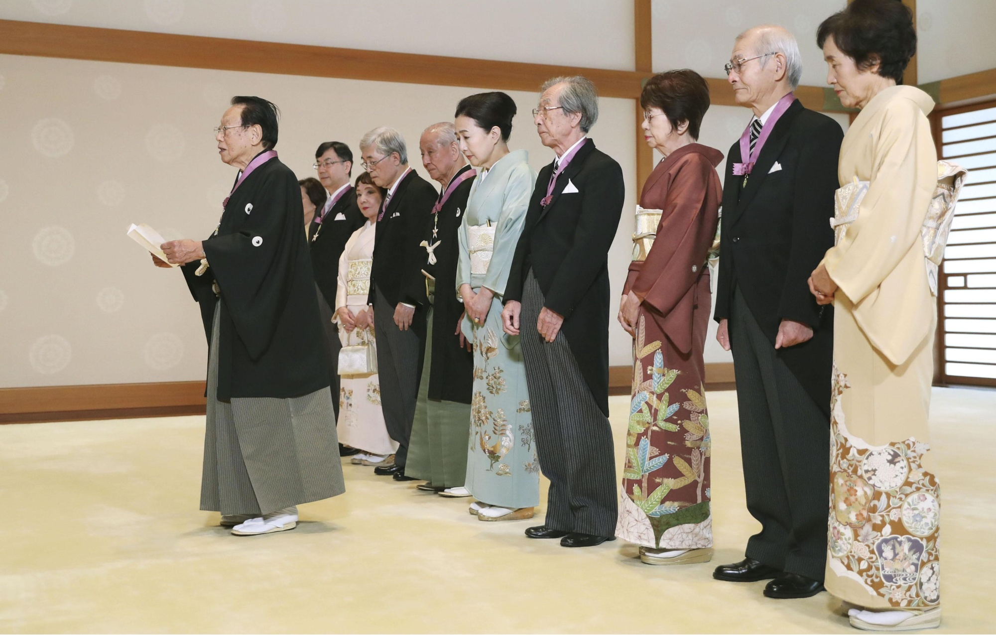Veteran photographer Takeyoshi Tanuma, 90, delivers a speech Sunday at the Imperial Palace as he and five other people, including Nobel chemistry laureate Akira Yoshino (second from right), 71, are granted the Order of Culture. | KYODO