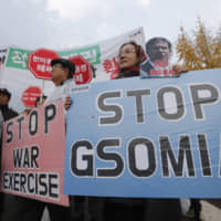 Protesters stage a rally against the General Security of Military Information Agreement (GSOMIA) intelligence-sharing pact between South Korea and Japan in front of the Defense Ministry in Seoul on Friday. | AP