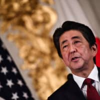 Prime Minister Shinzo Abe speaks during a joint news conference with U.S. President Donald Trump at Akasaka Palace in Tokyo on May 27. | AFP-JIJI