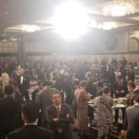 A photo provided by a participant of a dinner party held at Hotel New Otani a day before the cherry blossom-viewing event in April shows a crowd of attendees. | KYODO