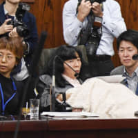 Disabled Japanese lawmaker makes history as first in wheelchair to attend Q&A session