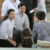 Crown Prince Naruhito and Crown Princess Masako meet with victims of the Great East Japan Earthquake in the town of Yamamoto, Miyagi Prefecture, in November 2011. | KYODO