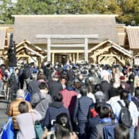 People visit the Daijokyu Halls at the Imperial Palace grounds in Tokyo on Thursday after they opened for a public viewing that will run daily through Dec. 8. Emperor Naruhito performed the Daijosai offering ceremony last week at the specially built halls. | KYODO