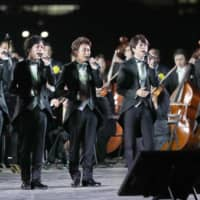 Members of Arashi, a popular all-male Japanese idol group, sing at the national festival held at the Imperial Palace Plaza in central Tokyo on Saturday to celebrate the enthronement of Emperor Naruhito. The imperial couple attended the event.   POOL / VIA KYODO